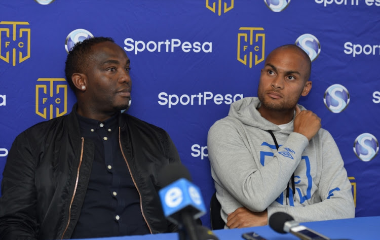 Cape Town City head coach Benni McCarthy (L) and club captain Robyn Johannes during a press conference at Cape Town Stadium on September 11, 2017 in Cape Town, South Africa.