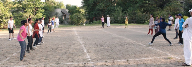 Photo: Students playing game in the evening