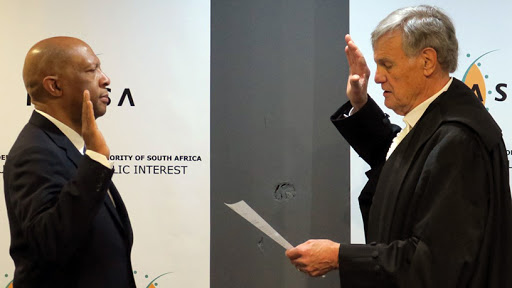 ICASA councillor Zolani Kgosietsile Matthews takes his oath of office. (Photo source: ICASA Twitter page)