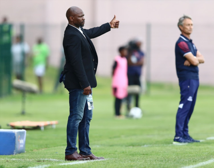 Steve Komphela of Golden Arrow and Muhsin Ertugral of Maritzburg United during the Absa Premiership match between Golden Arrows and Maritzburg United at Princess Magogo Stadium on January 06, 2019 in Durban, South Africa.