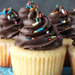Yellow Cupcakes with Chocolate Frosting.