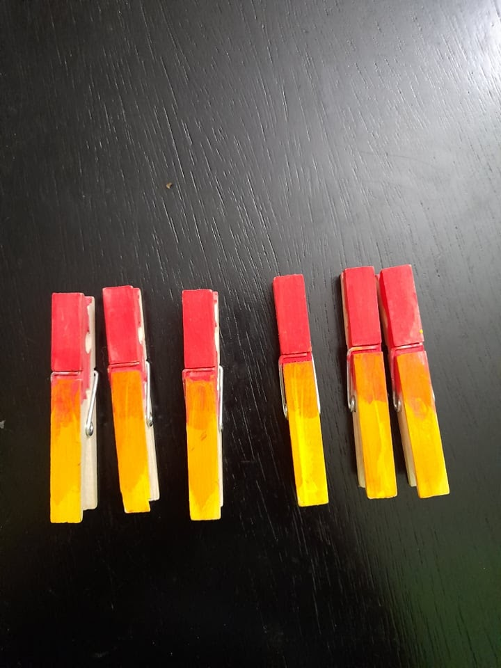 clothespins fully painted in red and yellow