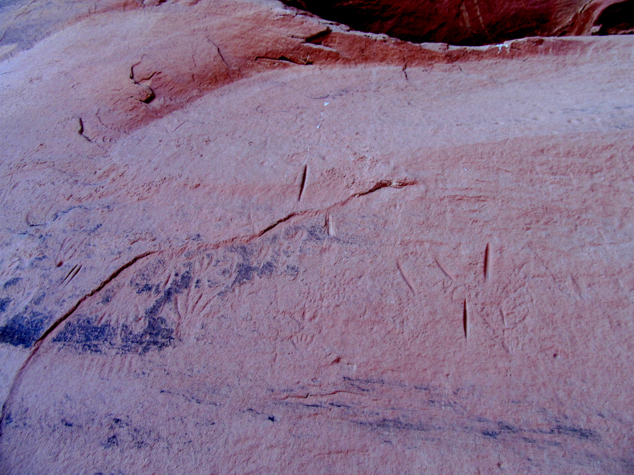 Photo: Badly weathered petroglyphs