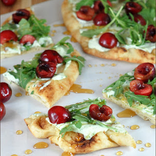 Cherry Pizza with Herbed Mascarpone and Arugula.