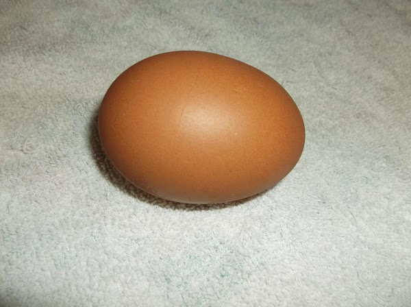 In a small bowl or cup, beat egg with fork.