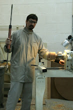 Photo: And now for the real hollowing: Keith Holt brandishes his weapon of choice -- heavy-duty Trent Bosch hollowing tools (straight and bent) in a double-ended Kelton handle. Keith alternates using both ends as he gets deeper.