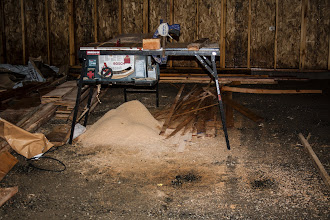 Photo: We had to rip a few more 45° strips.  I had to get a shot of the mound of sawdust.  That is from ripping bevelled plates and web-stiffeners.  We keep forgetting the fence at the shop :-)