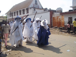 Photo: Eyo group dance as they parade the street