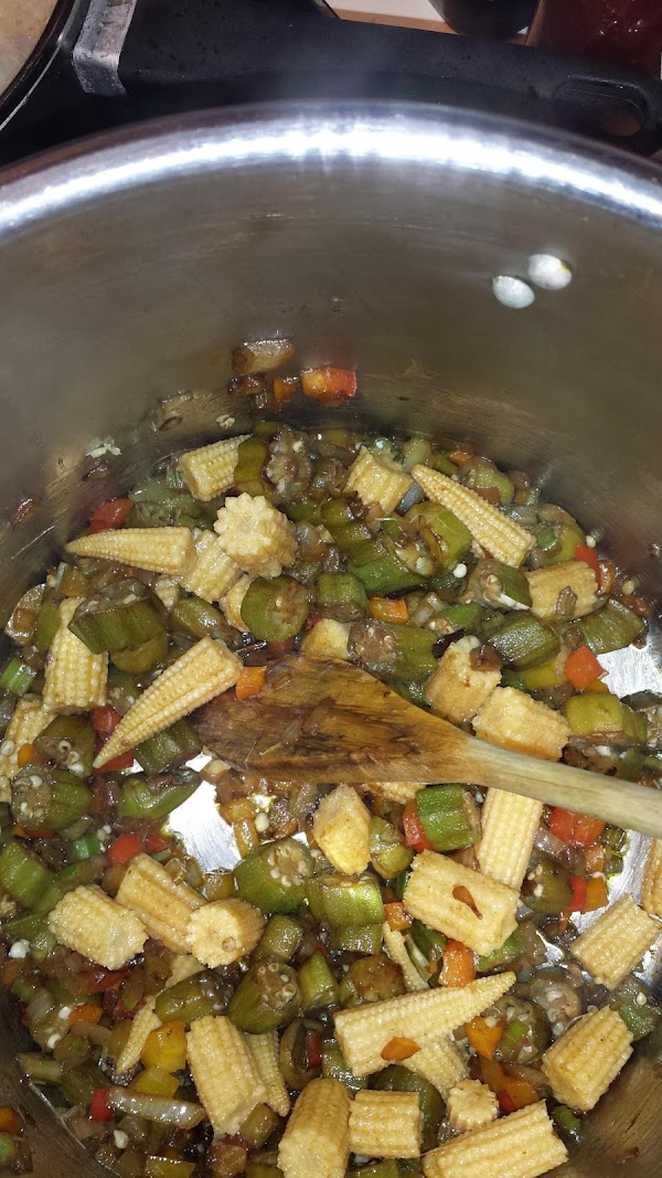 Add olive oil to the pan. Take the dice peppers, onion and celery and...