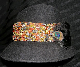 Photo: <KAPELUXE> Unique-Chique Hats by Luba Bilash ART & ADORNMENT  Midnight black wool felt fedora style base, crocheted multicoloured ribbon, detachable peacock feather clip, 360 degree possibilities. Can also be worn on an angle. (view B) Size L - 56 cm/22 in $80 SOLD