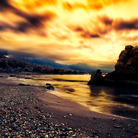 Eternal loneliness by Stavros Troullinos - Landscapes Beaches ( clouds, reflection, mountain, sea, rock, seaside, beach, soft, sky, sunset, snow, soft light, long exposure, gold, snow mountain, golden, golden hour )