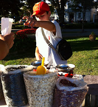 Photo: Ohrid city square.  Entrepreneurial kid selling nuts using an old weighted scale.