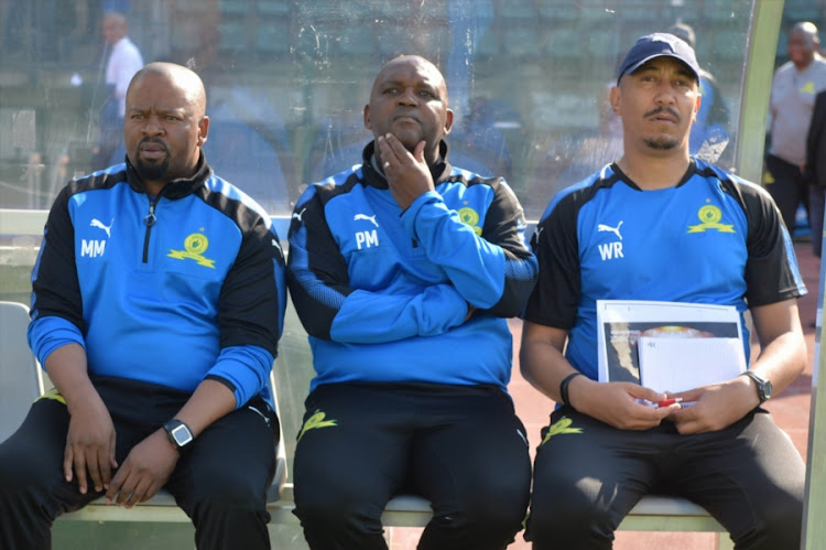 (From left to Right): Mamelodi Sundowns' head coach Pitso Mosimane is flanked by his assistants Manqoba Mngqithi (L) and Wendell Robinson.
