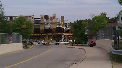 Photo: Marine railway crossing the road. Thats a boat in there.