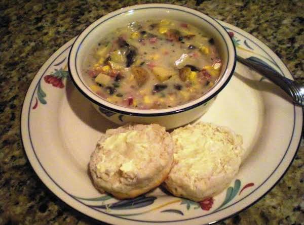 Corn Chowder With Bacon & Ham Served With A Warm Fluffy Biscuit.