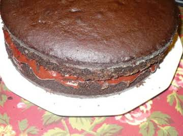 Choco-Cherry-Almond Naked Cake with Warm Cherry Sauce