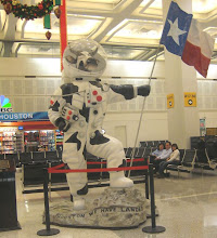 Photo: Houston-Hobby Airport... not quite sure why they have a cow in a spacesuit with the Lonestar flag (shouldn't it be a longhorn??)