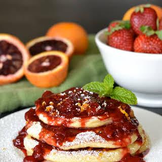 Blood Orange Ricotta Pancakes with Strawberry Orange Sauce.