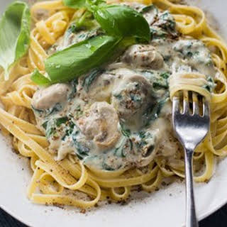Creamy Fettuccine With Caramelised Mushrooms And Baby Spinach.
