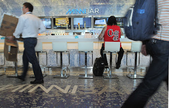 Photo: Minnbar, a new bar located on Concourse G at the Minneapolis St. Paul airport photographed on September 5, 2012 is one of several new spots a the airport for travelers. The bar which has no walls is definded by the tiles that surround the floor and ceililng. (Pioneer Press: Ginger Pinson)