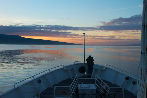 Dawn breaks over the deck of the National Geographic Endeavour on a Lindblad expedition to the Galapagos.