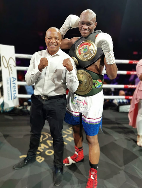 Promoter Lebo Mahoko and newly crowned SA and WBA Pan African middleweight champion Nkululeko Mhlongo celebrate their victory against Walter Dlamini.