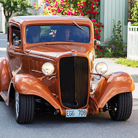 Chevrolet by Allan Wallberg - Transportation Automobiles ( model, old, glossy, automobile, street, chrome, vehicle, show, usa, city, american cars, american, stylish, idyllic, buildings, exhibition, yanks, classic, shiny, orange, sweden, houses, editorial, master busines, beautiful, class, front, lacquered, luxury, red, classic car, classical, groomed, chevrolet, headlights, polished, copper colored, town, view,  )