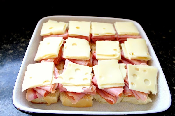 Ham and Swiss cheese layered on top of sweet rolls.
