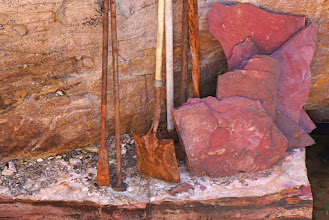 Photo: Depending upon the specific quarry, experience has shown that quarrying time can be estimated at two to six weeks. The layer of pipestone is sandwiched between layers of very hard Sioux Quartzite rock. Depending upon a quarry's location on the quarry line the upper layer of quartzite can be four to ten feet thick above the pipestone layer. Prairie plants and soil varying in depth from one to six feet cover the upper layer of quartzite. (2016 photo)