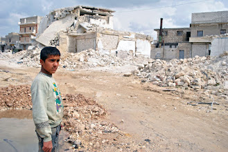 Photo: A young boy stands by the remains of a recent scud missile attack in the neighbourhood of Tariq al-Bab in Aleppo, Syria. Many homes in the area have been completely destroyed by government shelling. Aleppo, SYRIA - 11/4/ 2013. Credit: Ali Mustafa/SIPA Press