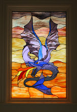 Photo: Bright colorful stained glass dragon, custom handmade and beautiful leaded glass. Replaced clear glass with stained glass thermopane unit. Allows for beauty and privacy. Fantasy, fiction, mystical, fantastical.
