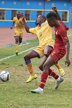 Photo: Haruna NIYONZIMA (8, Capt) fouled by Baba Rahman (17) [Rwanda Vs Ghana AFCON2017 Qualifier, 5 Sep 2015 in Kigali, Rwanda.  Photo © Darren McKinstry 2015