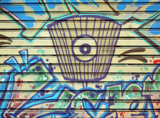 trippy-wall-art.jpg - The doors of factories lining the port for commercial ships are painted by public artists.