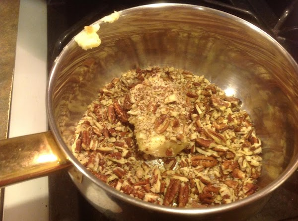 Using a small sauce pan add the 1/2 stick butter with chopped pecans or...