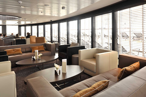 Relax and meet new friends in the lounge on L'Austral, a luxury ship from Ponant.