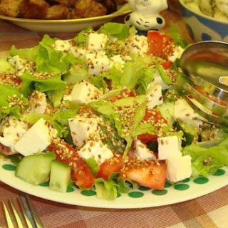 Vegetable Salad With Sesame Seeds And Mozzarella.