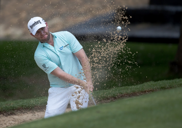 Branden Grace of South Africa out of the bunker on the 8th hole during day 3 of the 2018 BMW SA Open Championship at Glendower Golf Club on January 13, 2018 in Johannesburg, South Africa.