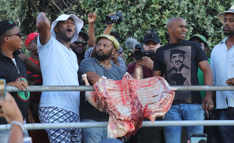 Demonstrators celebrate at Fourth Beach in Clifton on Friday December 28, 2018, after a sheep was slaughtered in a cleansing ceremony.
