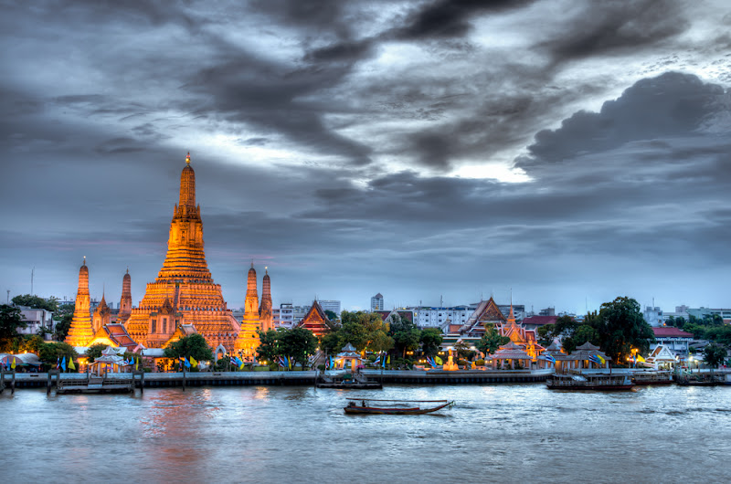 Photo: 112 of 365: Bangkok, Thailand. So I finally made it out to do some sightseeing today. It didn't take me long to realize that traveling in this city is a pain in the ass. After a tuk tuk, two trains, and a ferry I finally made it to this view of the Wat Arun temple on the banks of the Chao Phraya River. I did find a sweet little café overlooking the river that made me feel like I was in Venice so that was a plus. I'm sure I'll look back at this shot in a week and think I over-processed it, but I had to do something to make this colorless image standout and B&W just didn't do it for me. I think Bangkok got the best of me today as too many things just didn't go my way. I've decided to move forward and head to Chiang Mai and northern Thailand. I'm looking forward to some cooler weather and seeing the highlands, after a stop at the famous night market of course. Some more amazing food awaits…  +G+ 365 Project  #Bangkok   #Thailand   #HDR   #temple