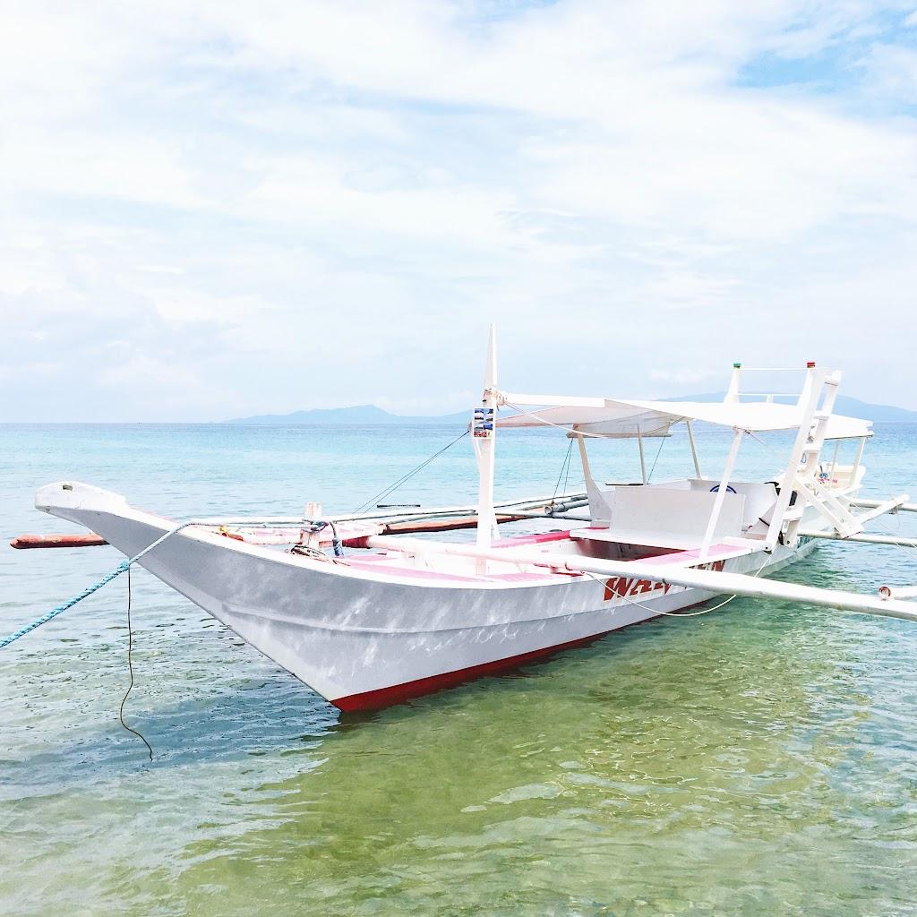 el canonero beach resort puerto galera oriental mindoro white boat sailing