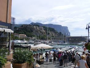 Photo: Now back at sea level, with the tourist harbor of Cassis starting to appear. Cassis is said to be packed in the summer, reverting to a quieter fishing village off-season, and at this time we have caught it a bit between the two.