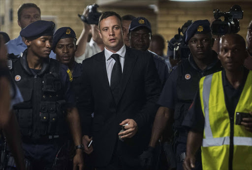 FILE PHOTO: Oscar Pistorius arrives court sentencing