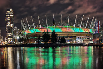 Photo: Vancouver's BC Place stadium seen from south Fasle Creek at the Olympic Village. Zuiko 24mm/2.8 manual focus lens.