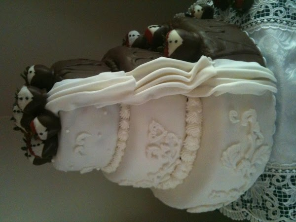 Set pinched and creased fondant down the sides to create drape.