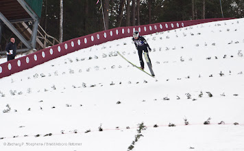Photo: Yuya Yamada of Japan flies to a landing during day one at the Harris Hill Ski Jump in Brattleboro on Saturday.(Zachary P. Stephens/Brattleboro Reformer)