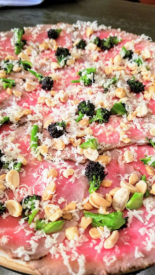 Quaintrelle, Pacific Northwest cuisine focused Portland restaurant that emphasizes 80-85% local ingredients. Start dish option of raw beef, purple sprouting broccoli, peanuts, horseradish