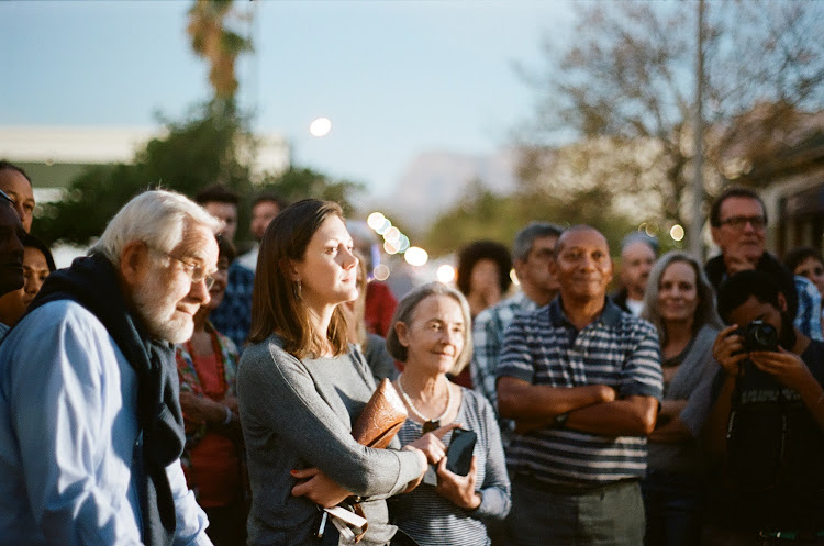 "Residents of Die Vlakte, led by Wilfred Damon, will take the audience on a tour of their memories behind contemporary Stellenbosch. ""Wherever you see a parking lot - that's where we lived"". The tour will be given in Afrikaans, translated into English."