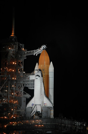 Space Shuttle Atlantis is in the spotlight on Launch Pad 39B.