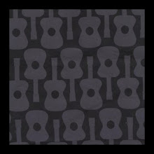 Photo: Gray Groovy Guitars *Lennon* Special Note *will coordinate with purple or black straps