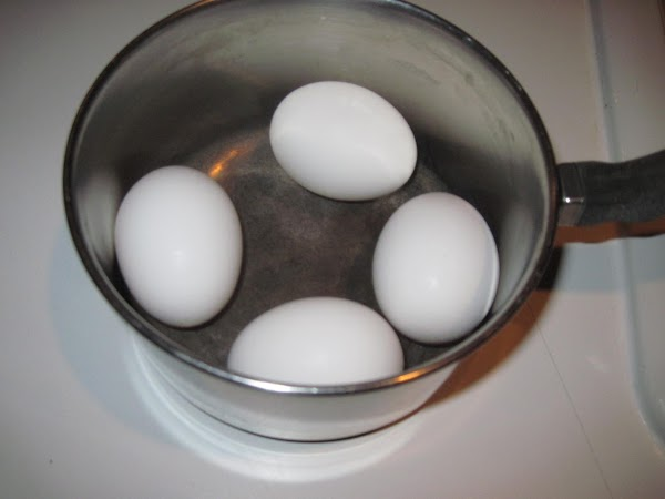 Hard boil eggs and cool.